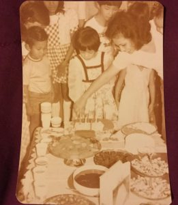 Author and her mom cutting 6th birthday cake