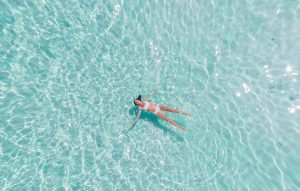 image of girl floating in a pool